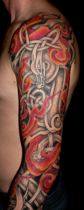 Detail shot of Celtic dragon sleeve tattoo